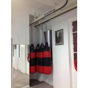 Rail de convoyage pour sacs à double distribution