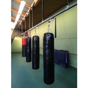 Rail de convoyage pour sacs sur consoles verticales